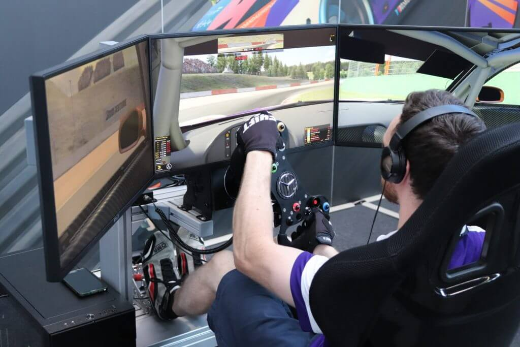 sim rig featuring triple monitors