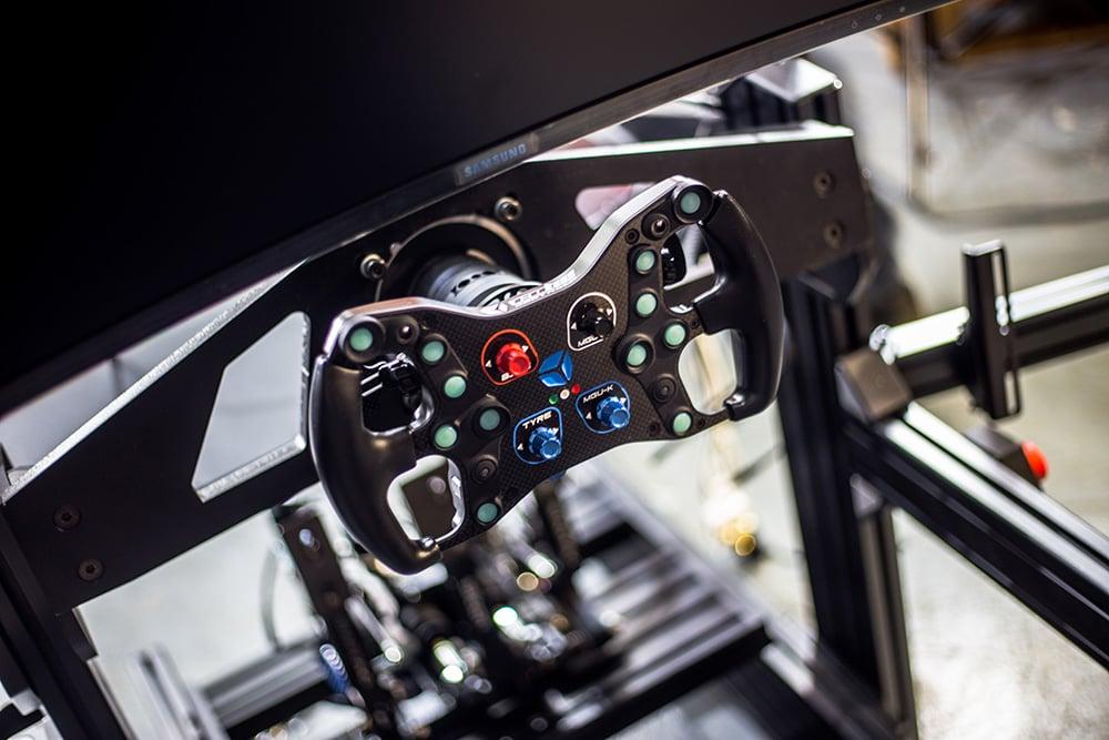 Cube Controls Formula Sport sim steering wheel mounted to a custom built sim rig from Digital Motorsports